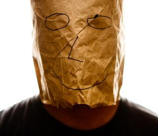 brown_paper_bag_with_happy_smiley_over_head